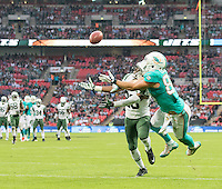04.10.2015. Wembley Stadium, London, England. NFL International Series. Miami Dolphins versus New York Jets. Miami Dolphins Tight End Jordan Cameron attempts to catch the ball from Miami Dolphins Quarterback Ryan Tannehill in the End Zone before New York Jets Cornerback Marcus Williams.