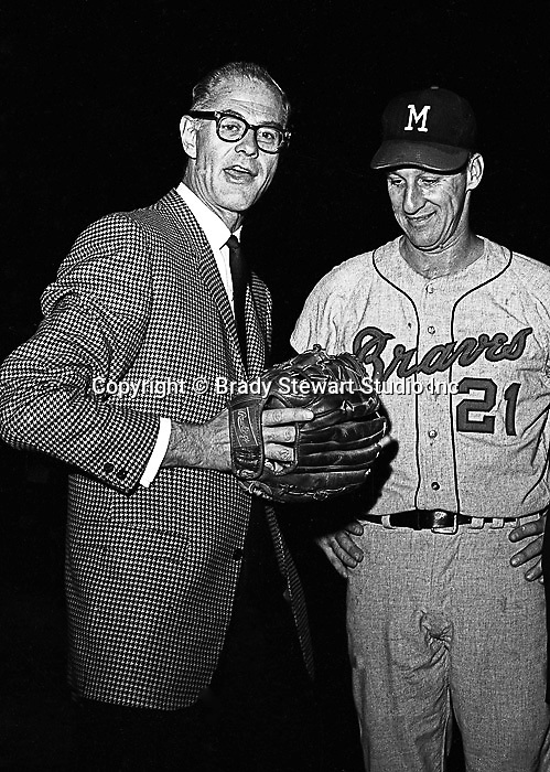 "Pittsburgh PA:  Warren Spahn talking with Pittsburgh Pirate announcer, Bob ""the Gunner"" Prince at the HYPO charity baseball game with the Milwaukee Braves - 1965. The money raised by HYPO (Help Young Players Organize) was used to help local communities buy equipment and build ball fields"