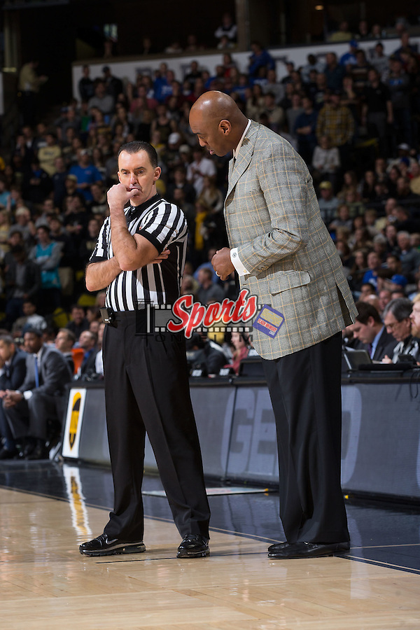 Referee Roger Ayers has a discussion with Wake Forest Demon Deacons head coach Danny Manning during second half action against the Duke Blue Devils at the LJVM Coliseum on January 6, 2016 in Winston-Salem, North Carolina.  The Blue Devils defeated the Demon Deacons 91-75.  (Brian Westerholt/Sports On Film)