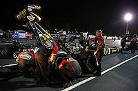 Sep 27, 2013; Madison, IL, USA; Crew members change the rear tire on the NHRA top fuel dragster of Khalid Albalooshi during qualifying for the Midwest Nationals at Gateway Motorsports Park. Mandatory Credit: Mark J. Rebilas-