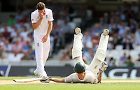 Chris Rogers of Australia takes a tumble - England vs Australia - 1st day of the 5th Investec Ashes Test match at The Kia Oval, London - 21/08/13 - MANDATORY CREDIT: Rob Newell/TGSPHOTO - Self billing applies where appropriate - 0845 094 6026 - contact@tgsphoto.co.uk - NO UNPAID USE