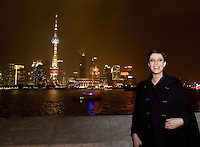 EXCLUSIVE - Anna Mouglalis poses for a photograph in front of the Oriental TV Tower and the Pudong skyline, considered the symbol of Shanghai, at Chanel Fashion Show in Shanghai, on December 3, 2009. Photo by Lucas Schifres/Pictobank