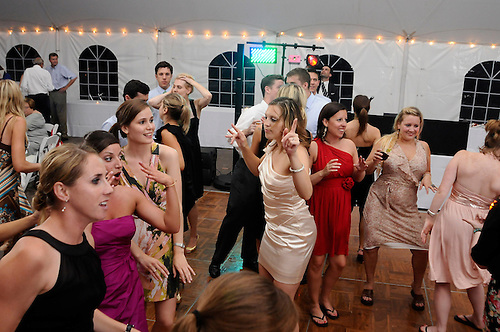 The wedding celebration in a tent on the grounds of Total Tennis in Saugerties, New York.a