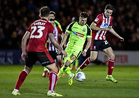 Bolton Wanderers' Dennis Politic breaks under pressure from Lincoln City's Conor Coventry (right) and Neal Eardley (left) <br /> <br /> Photographer Andrew Kearns/CameraSport<br /> <br /> The EFL Sky Bet League One - Lincoln City v Bolton Wanderers - Tuesday 14th January 2020  - LNER Stadium - Lincoln<br /> <br /> World Copyright © 2020 CameraSport. All rights reserved. 43 Linden Ave. Countesthorpe. Leicester. England. LE8 5PG - Tel: +44 (0) 116 277 4147 - admin@camerasport.com - www.camerasport.com