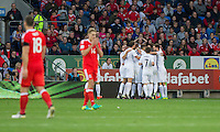 Tornike Okriashvili of Georgia is mobbed after scoring his side's first goal during the FIFA World Cup Qualifier match between Wales and Georgia at the Cardiff City Stadium, Cardiff, Wales on 9 October 2016. Photo by Mark  Hawkins / PRiME Media Images.