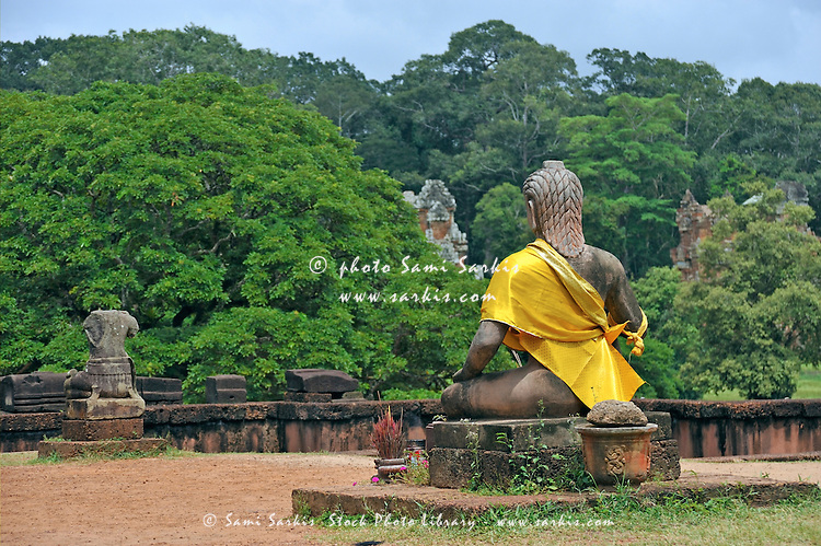 Buddha statue wearing a yellow sash at Angkor Wat, Cambodia