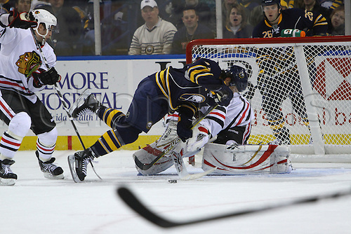 11 December 2009: Buffalo Sabres left wing Clarke MacArthur (41) goes flying across the goal during a game against the Chicago Blackhawks at the HSBC Arena in Buffalo, NY. Photo by Jerome Davis/Actionplus. UK Licenses Only