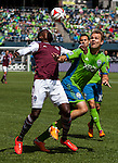 Colorado Rapids Edson Buddle, right,  heads the ball while being guarded by Seattles' Chad Marshall during an MLS match on April 26, 2014 in Seattle, Washington.  The Seattle Sounders beat the Colorado Rapids 4-1.  Jim Bryant Photo. ©2014. All Rights Reserved.