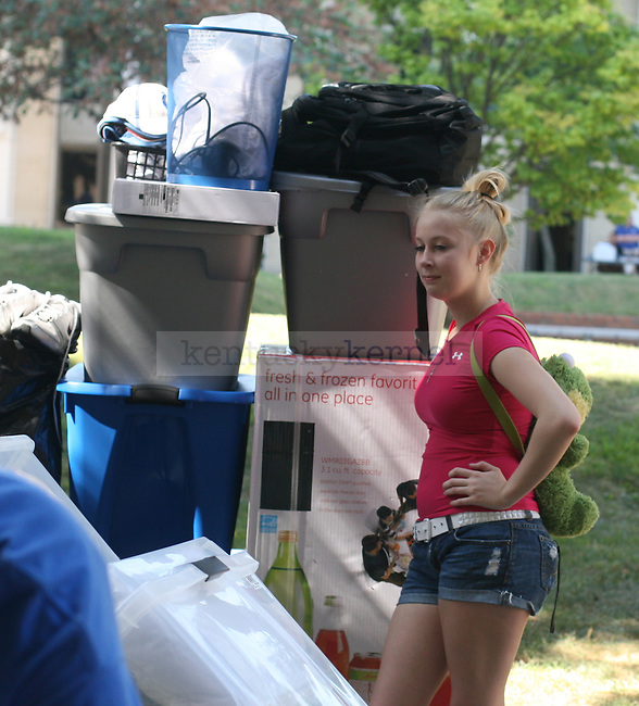 A sibling of a freshman UK student waits to help during move in on August 20, 2010.