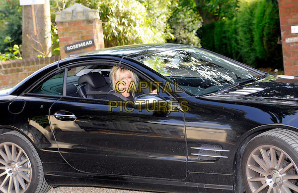 JO WOOD.Leaving Lifeworks after visiting husband Ronnie at his treatment clinic, Old Woking, Surrey, England, 19th August 19th 2008..portrait headshot driving in car black rehab.CAP/DH.©David Hitchens/Capital Pictures