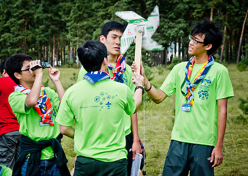 Singaporean scouts trying their new windmill at the Earth activity.