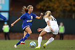 14 November 2014: South Dakota State's Ashley Adams (CAN) (9) and North Carolina's Megan Buckingham (18). The University of North Carolina Tar Heels hosted the South Dakota State University Jackrabbits at Fetzer Field in Chapel Hill, NC in a 2014 NCAA Division I Women's Soccer Tournament First Round match. UNC won the game 2-0.