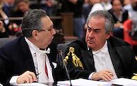 L'avvocato Franco Coppi parla col suo collega Paolo Loria, a destra, durante l'udienza conclusiva del processo per il delitto di Via Poma, presso la Corte d'Appello di Roma, 27 aprile 2012..UPDATE IMAGES PRESS/Riccardo De Luca