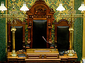 "Close-up of the Speaker's chair of the House of Representatives Chamber inside the Michigan State Capitol, which opened on January 1, 1879 in Lansing, Michigan on Saturday, June 29, 2018. It was designed by architect Elijah E. Myers, and is one of the first state capitols to be topped by a lofty cast iron dome, that was modeled on the dome of the United States Capitol in Washington, DC. The word ""Tuebor"" at left and right, which is also on the Michigan flag, means ""I will defend.""<br /> Credit: Ron Sachs / CNP"