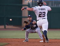 NWA Democrat-Gazette/J.T. WAMPLER The Naturals' Frank Schwindel gets thrown out at second base by Benji Gonzalez Thursday Aug. 13, 2015 during the Naturals game against the San Antonio Missions at Arvest Ballpark in Springdale.