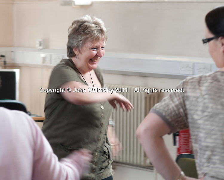A carer joining in, Movement & Music, Learning Support group,  Adult Learning Centre, Guildford, Surrey.