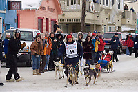 Nome resident and 18 year old Melissa Owens, brings her dogs down Nome's Front Street about to take 30th place during Iditarod 2008