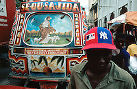 "Haiti. Province of Ouest. Port-Au-Prince. Downtown. Market area. Densely populated area.  Public transport ""Tap Tap"". Collective taxis. © 2003 Didier Ruef"