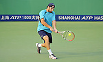SHANGHAI, CHINA - OCTOBER 10:  Robby Ginepri of the US returns a ball against Ya-Nan Ma of China during the Day 1 of the 2009 Shanghai ATP Master 1000 at the Qi Zhong Tennis Centre in Shanghai. Photo by Victor Fraile / The Power of Sport Images