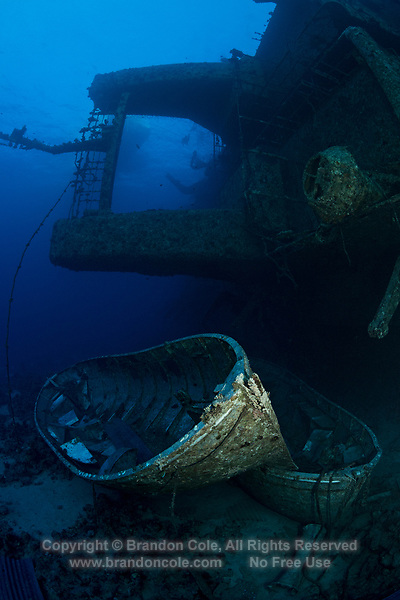 TG0012-D. Two lifeboats rest on the seafloor in 100 feet next to the wreck of the Salem Express. A 330 foot long passenger ferry, it was carrying hundreds of people on pilgrimage, bringing them back from Mecca  when it sank in the Hyndman Reefs off Safaga in 1991 after colliding with coral at night in foul weather. The majority of people onboard-- at least 470, and some speculate the number could have been much higher&mdash; lost their lives. The ship sank so quickly that the lifeboats were never deployed. Egypt, Red Sea.<br /> Photo Copyright &copy; Brandon Cole. All rights reserved worldwide.  www.brandoncole.com