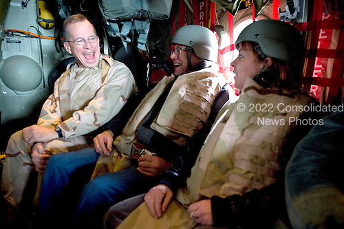 Kandahar, Afghanistan - December 17, 2008 -- United States Navy Admiral Mike Mullen, chairman of the Joint Chiefs of Staff, left,  enjoys a laugh with comedians Lewis Black, center, and Kathleen Matigan, right, en route to Kandahar, Afghanistan during the 2008 USO Holiday Tour on Wednesday, December 17, 2008.  Along with his wife Deborah, Mulllen welcomed comedian John Bowman; actress Tichina Arnold; American Idol contestant and country musician Kellie Pickler and Grammy award winning musician Kid Rock on the tour bringing music and entertainment to service members and their families stationed overseas. .Credit: Chad J. McNeeley - DoD via CNP