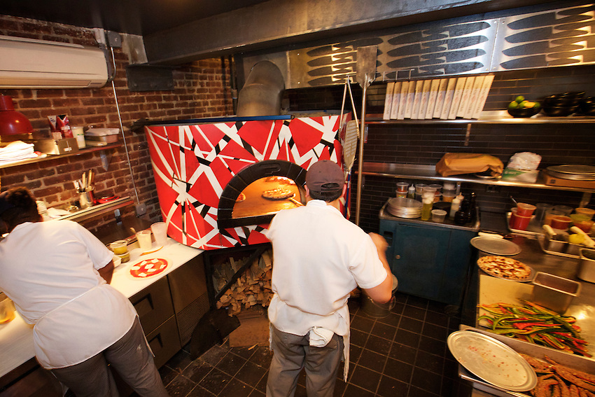 New York, NY - March 26, 2016: The pizza oven, Painted to look like Eddie Van Halen's &quot;Frankenstrat&quot; guitar at Speedy Romeo's new location, opening in the Lower East Side.<br /> <br /> CREDIT: Clay Williams for Gothamist.<br /> <br /> &copy; Clay Williams / claywilliamsphoto.com
