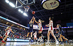 SIOUX FALLS, SD - MARCH 8: Sarah Garvie #32 of Oral Roberts and Taylor Frederick #15 of South Dakota battle for a rebound at the 2020 Summit League Basketball Championship in Sioux Falls, SD. (Photo by Richard Carlson/Inertia)