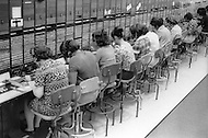 Brooklyn, New York City, NY. April,1974.<br /> Last women telephone switchboard operators working at AT&amp;T telephone center in Brooklyn.<br /> 911 was dialed for getting any information, while 0 was dialed for long distance calls.
