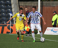 Sammy Clingan shielding the ball from Adam Drury in the Kilmarnock v St Mirren Scottish Professional Football League Premiership match played at Rugby Park, Kilmarnock on 13.9.14.