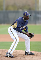 Roque Mercedes #66 of the Milwaukee Brewers participates in pitchers fielding practice during spring training workouts at the Brewers complex on February 18, 2011  in Phoenix, Arizona. .Photo by Bill Mitchell / Four Seam Images.