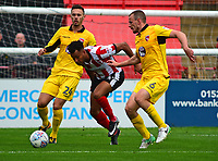 Lincoln City's Matt Green gets between Morecambe's Michael Rose, (left) and Dean Winnard<br /> <br /> Photographer Andrew Vaughan/CameraSport<br /> <br /> The EFL Sky Bet League Two - Lincoln City v Morecambe - Saturday August 12th 2017 - Sincil Bank - Lincoln<br /> <br /> World Copyright &copy; 2017 CameraSport. All rights reserved. 43 Linden Ave. Countesthorpe. Leicester. England. LE8 5PG - Tel: +44 (0) 116 277 4147 - admin@camerasport.com - www.camerasport.com
