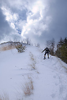 A backcountry skier climbs a dune in the Grand Sable Dunes in Pictured Rocks National Lakeshore.