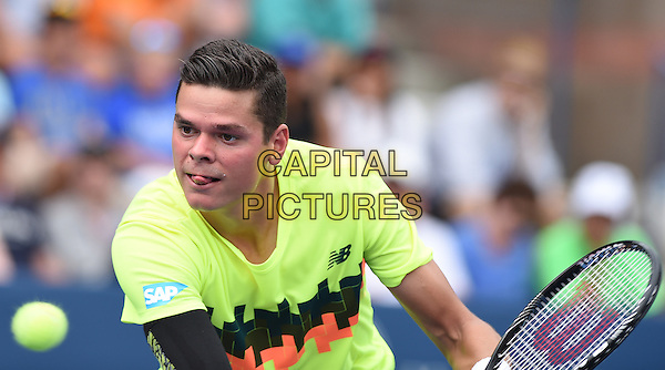 FLUSHING NY- AUGUST 30:  Victor Estrella Burgos Vs Milos Raonic on Grandstand at the USTA Billie Jean King National Tennis Center. Milos Raonic returns a volley against Victor Estrella Burgos during their match on August 30, 2014 in Flushing Queens. <br /> CAP/MPI/MPI04<br /> &copy;MPI04/MPI/Capital Pictures