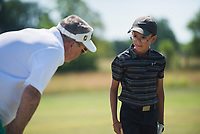 NWA Democrat-Gazette/CHARLIE KAIJO Robbie Robinson of Bella Vista (from left) gives notes to Jude Martinez, 10, of Bentonville during a junior golf tournament, Sunday, June 10, 2018 at The First Tee Learning Center in Lowell.<br />