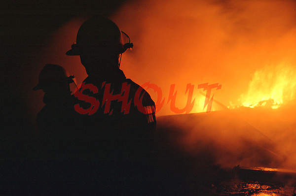 Firefighters attacking a fire in an industrial park. They are using a main jet to try and stop the fire spreading to other units. This image may only be used to portray the subject in a positive manner..©shoutpictures.com..john@shoutpictures.com