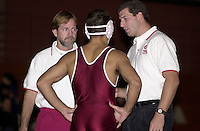 Shawn Harmon gets advice from Chris Horpel (l) and Steve Buddie (r) while wrestling against San Francisco State on November 14, 2000 at Burnham Pavilion.
