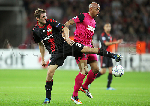 28.09.2011. Marseilles, France.  Leverkusen's Stefan Reinartz (L) and Genk's Marvin Ogunjimi fight for the ball during the Champions League group E match between Bayer Leverkusen and KRC Genk at the BayArena in Leverkusen, Germany, 28 September 2011.
