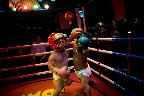Sometimes, the midgets box as well as wrestle. Sometimes they wear nappies.<br />