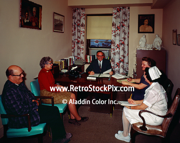 Evangelical Manor Philadelphia, PA. Nursing Home administrator having a meeting in his office.