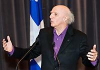 "Quebec singer Gilles Vigneault gestures in a press conference announcing government money for the Festival des musiques sacrÈes de QuÈbec (Quebec sacred music festival) where Vigneault will compose and produce ""La Grande-messe"" (the Great Mass) with Bruno Fecteau."