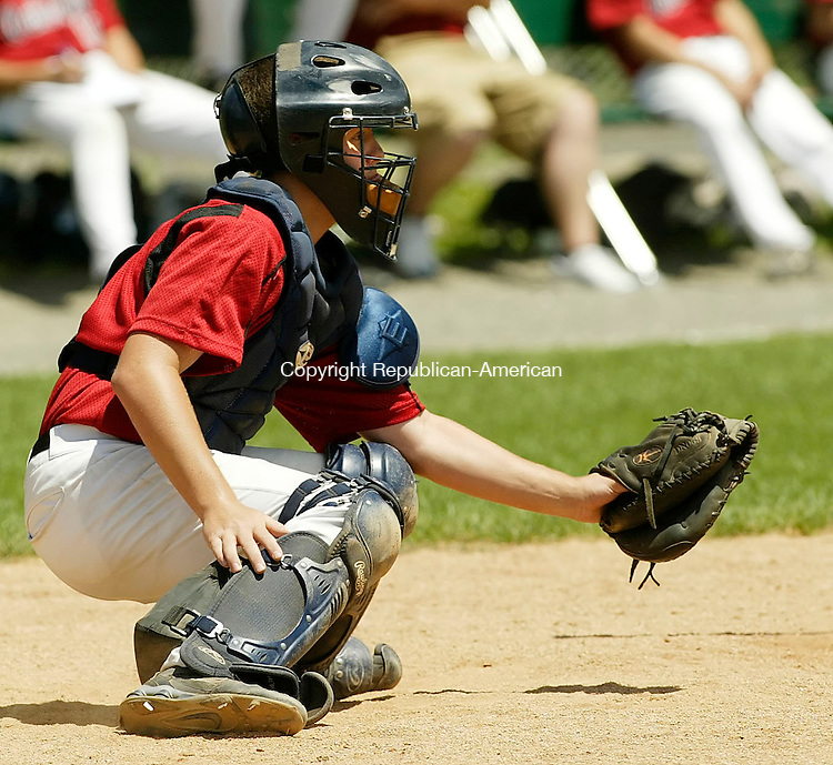 WATERTOWN, CT 07/13/08- 071308BZ16- Oakville's Johnny LoVetere (9) catches against the Admirals during an American Legion game at the Taft School in Watertown Sunday afternoon.<br />  Jamison C. Bazinet Republican-American