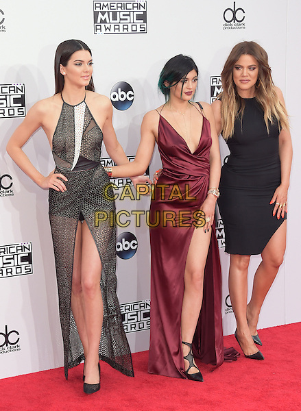 Kendall Jenner,Kylie Jenner, Khloe Kardashian at The 2014 American Music Award held at The Nokia Theatre L.A. Live in Los Angeles, California on November 23,2014                                                                                <br /> CAP/RKE/DVS<br /> &copy;DVS/RockinExposures/Capital Pictures