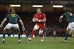 Wales lock Alun Wyn Jones takes on Springok pair Jean De Villiers and Flip Van Der Merwe.<br /> <br /> 2013 Dove Men Series<br /> Wales v South Africa<br /> Millennium Stadium<br /> 09.11.13<br /> ©Steve Pope-Sportingwales
