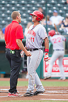 Hagerstown Suns trainer Don Neidig checks on Drew Ward (11) as he grimaces in pain after fouling a ball off his right leg during the game against the Greensboro Grasshoppers at NewBridge Bank Park on May 20, 2014 in Greensboro, North Carolina.  The Grasshoppers defeated the Suns 5-4. (Brian Westerholt/Four Seam Images)