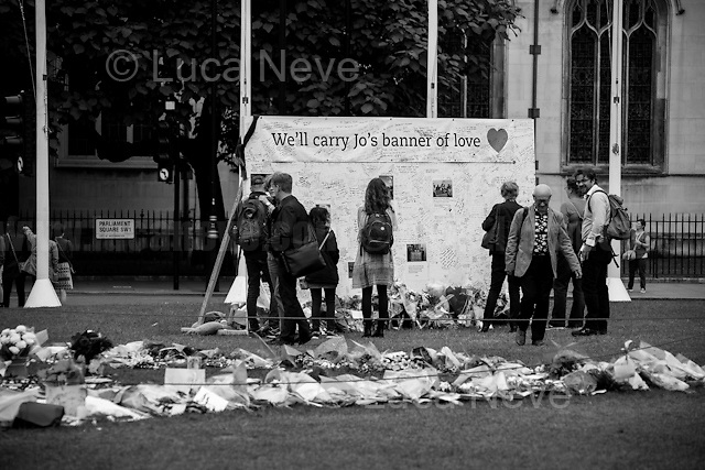 """Memorial for Jo Cox MP in London's Parliament Square (Jo Cox was a Labour Member of Parliament who was brutally killed by the far-right extremist Thomas Mair on the 16th of June 2016).<br /> <br /> London, March-July 2016. Reporting the EU Referendum 2016 (Campaign, result and outcomes) observed through the eyes (and the lenses) of an Italian freelance photojournalist (UK and IFJ Press Cards holder) based in the British Capital with no """"press accreditation"""" and no timetable of the main political parties' events in support of the RemaIN Campaign or the Leave the EU Campaign.<br /> On the 23rd of June 2016 the British people voted in the EU Referendum... (Please find the caption on PDF at the beginning of the Reportage).<br /> <br /> For more information about the result please click here: http://www.bbc.co.uk/news/politics/eu_referendum/results"""