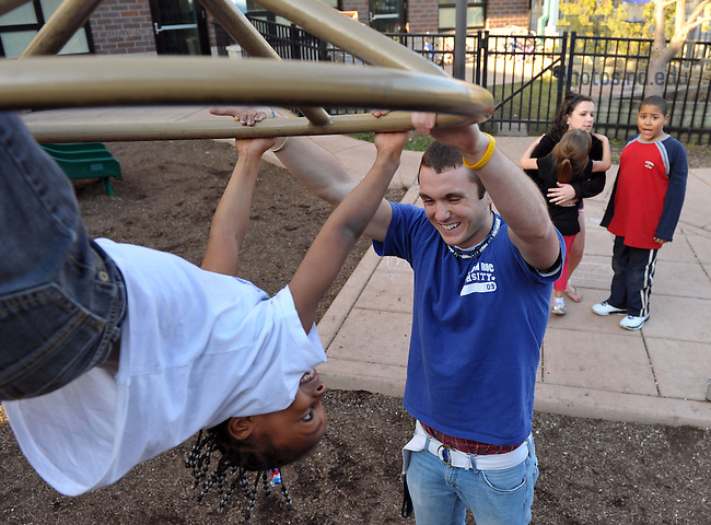 Andrew Lamb '12 plays with a guest at the Center for the Homeless in South Bend...Photo by Matt Cashore/University of Notre Dame