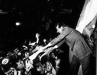 Montreal (QC) CANADA Nov 17 1985 file photo - Robert Bourassa, Liberal Party leader shake hands with the crowd at a fan rally before the Provincial election