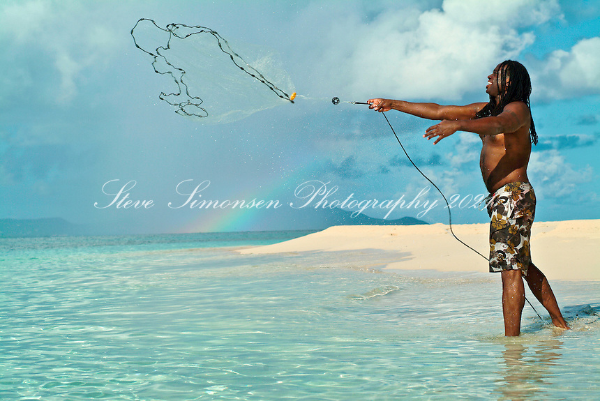Fisherman throwing a net<br /> St Croix<br /> U.S. Virgin Islands