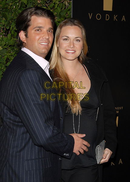DONALD TRUMP JR. & VANESSA TRUMP.Attends The Drinks America Launch Party for Trump Vodka held at Les Deux in Hollywood, California, USA. .January 17th, 2007.half length blue pinstripe suit black trousers coat pregnant couple married husband wife .CAP/DVS.©Debbie VanStory/Capital Pictures