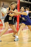 07.08.2010 Silver Ferns Irene Van Dyk and Samoa's Sanonu Robertson in action during the Silver Ferns v Samoa netball test match played at Te Rauparaha Arena in Porirua  Wellington. Mandatory Photo Credit ©Michael Bradley.
